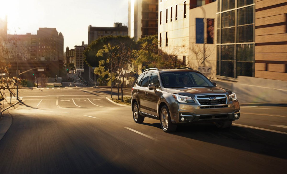 Subaru Forester 2018 - car insurance rates - 2.5i Touring shown in Sepia Bronze Metallic with available EyeSight® Driver Assist Technology