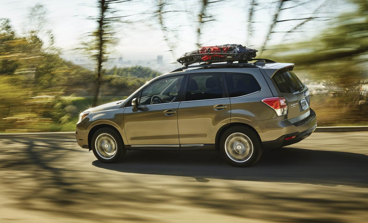 Subaru Forester 2018 - car insurance rates - 2.5i Touring shown in Sepia Bronze Metallic with available accessory equipment