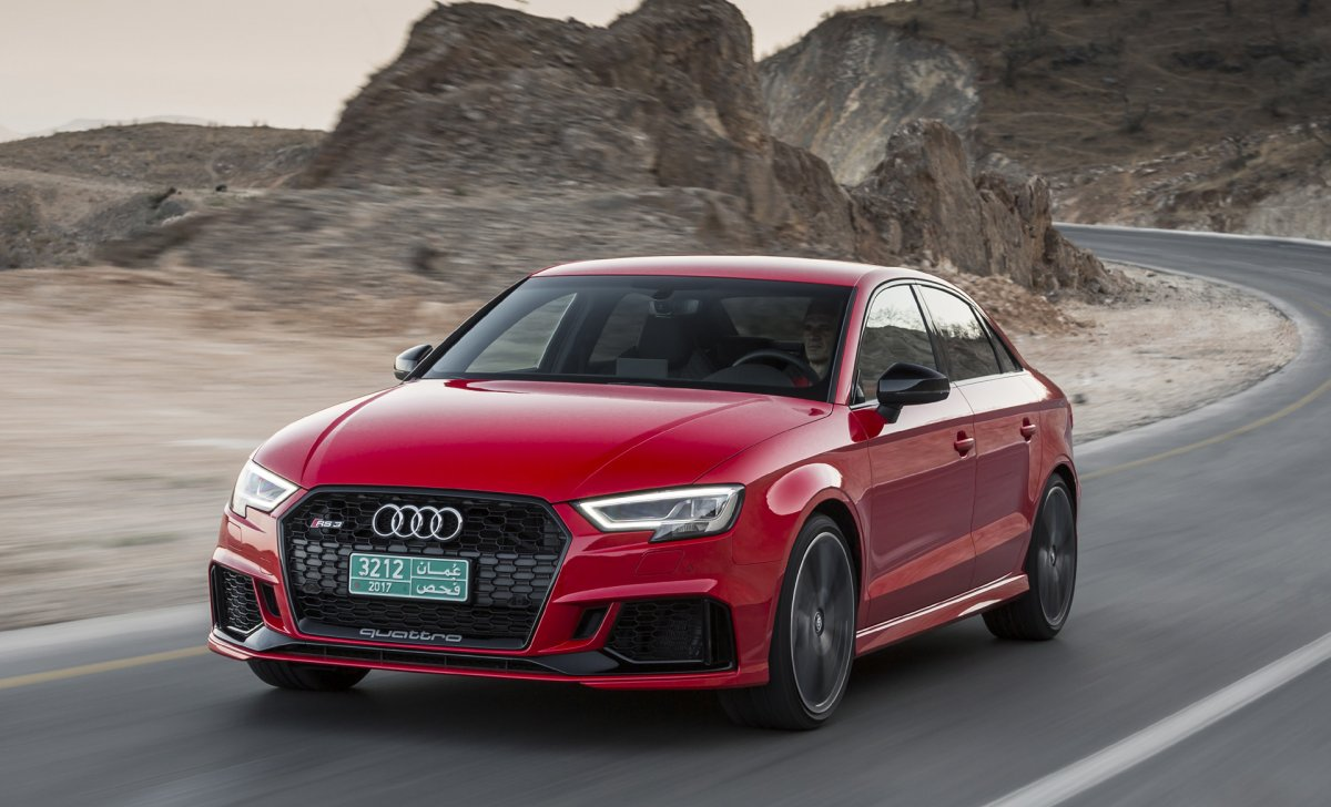 Audi A3 2018 - car insurance - red color, front view on the road, mountines