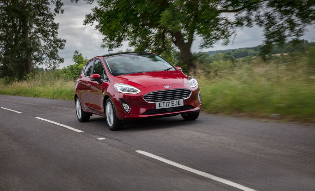 Car insurance for Ford Fiesta 2018 - red color on the road