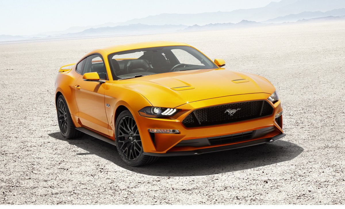 2018 Ford Mustang - Car insurance - yellow color road, sand, front view