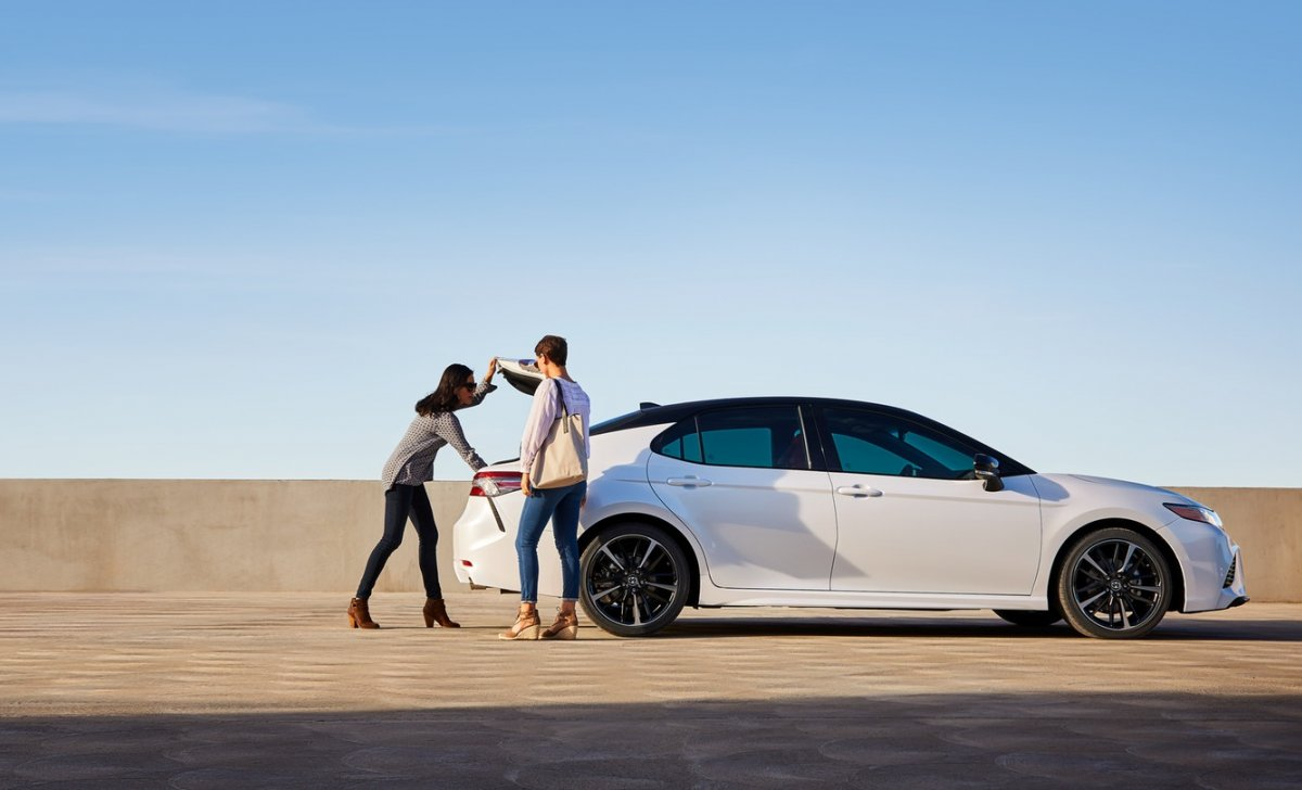 Toyota Camry 2018 - car insurance - white color on the desert and sand
