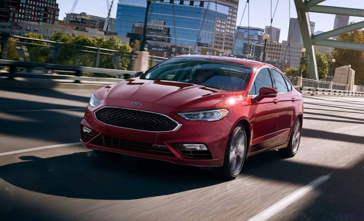 2018 Ford Fusion - Car Insurance - red color on the road front view