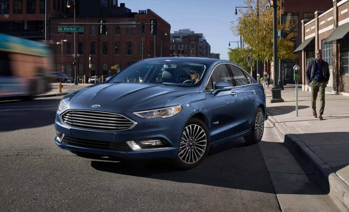 2018 Ford Fusion - Car Insurance - blue color front view on the road