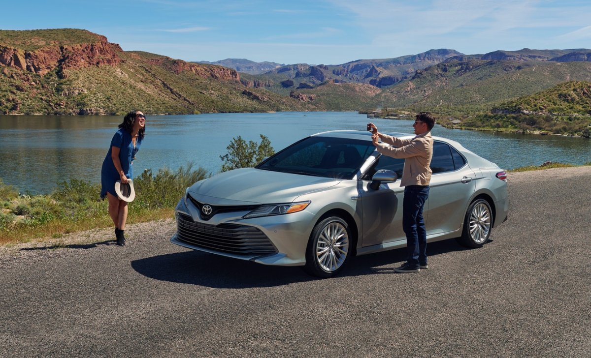 Toyota Camry Hybrid 2018 - car insurance - people on the trip camry close river, weekend