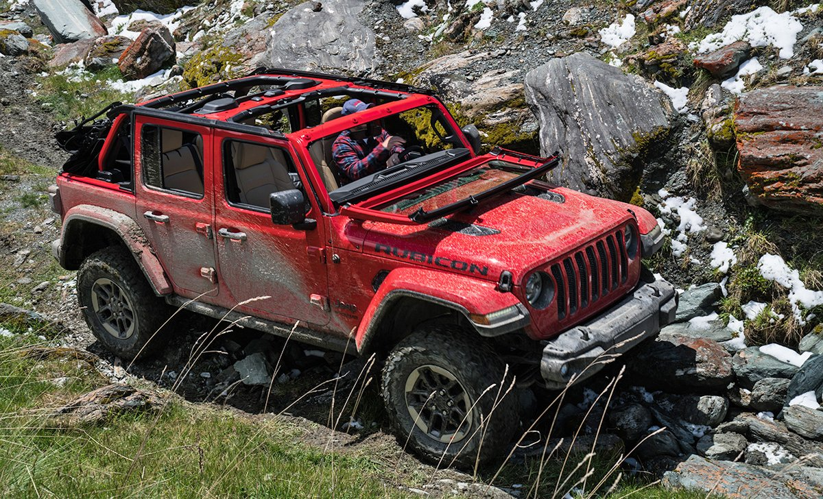 2018 Jeep Wrangler - car insurance - red color side rear view in terrain