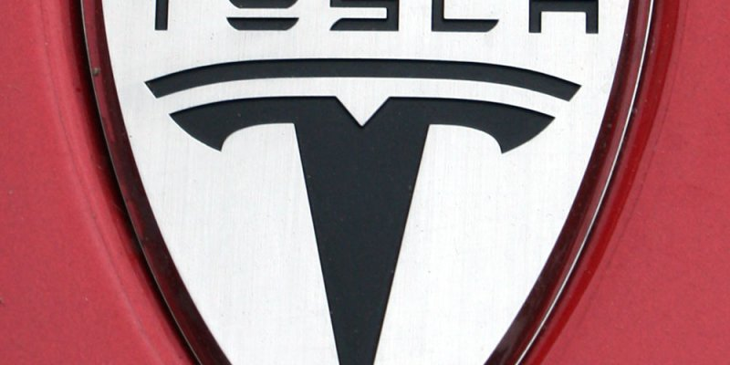 Tesla logo - car insurance