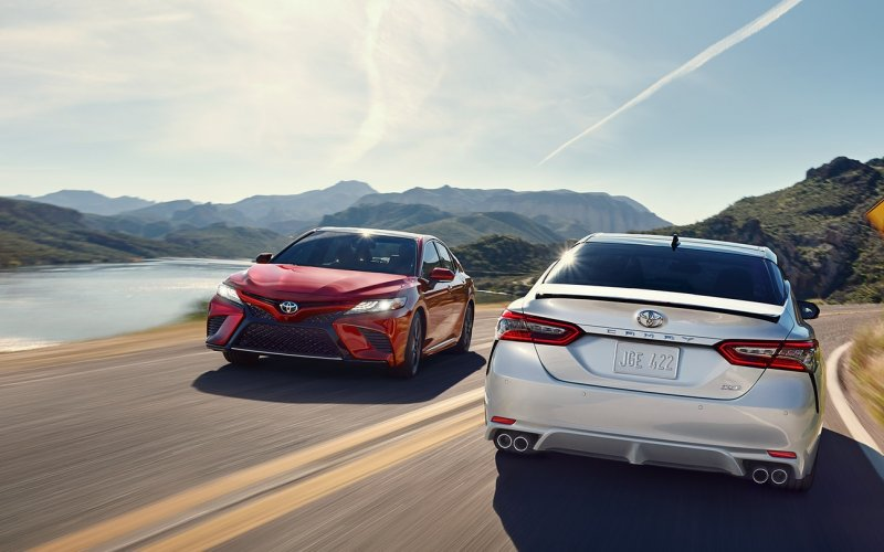Toyota Camry 2018 - driving on the road - red and white trim
